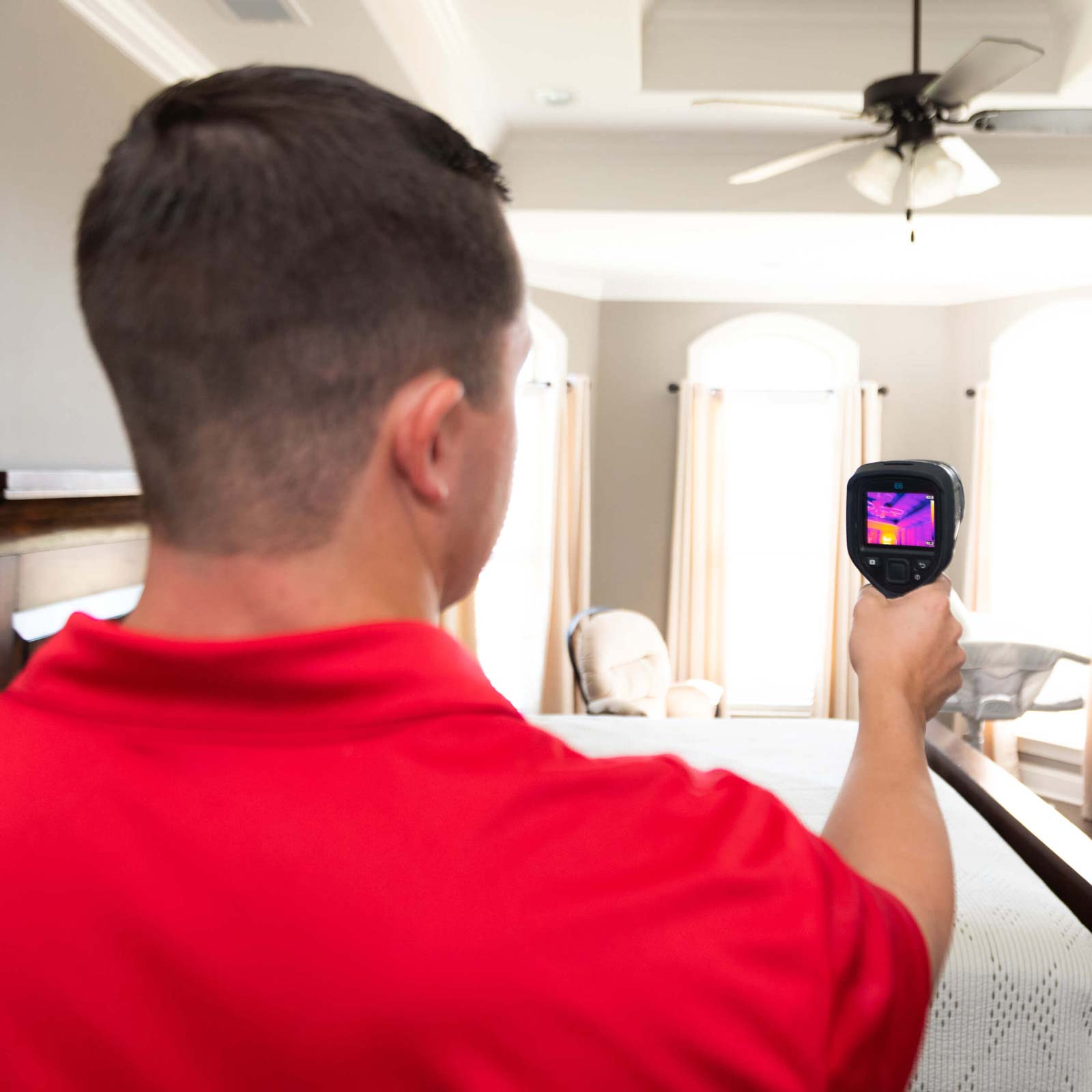 Home Inspector Colin Wilson using thermal imaging to assist in home inspection